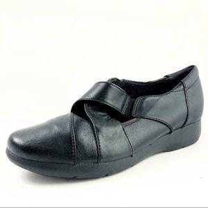 Women's Black Leather Cross Strap Slip-on Loafers.